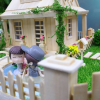 Popsicle stick house with garden template